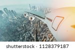 aircraft flying in the city...   Shutterstock . vector #1128379187