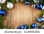 Christmas background of blue and silver balls over wooden table - stock photo