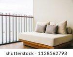 comfortable pillow on sofa... | Shutterstock . vector #1128562793