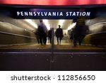Blur of commuters rushing down the steps to Pennsylvania Station subway in New York City - stock photo