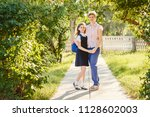 happy mom and daughter... | Shutterstock . vector #1128602003