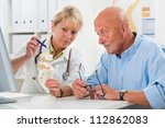 physical therapist talking to... | Shutterstock . vector #112862083