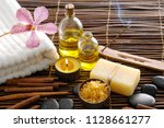 spa setting with orchid oil ... | Shutterstock . vector #1128661277