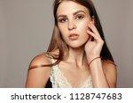 beauty woman face portrait.... | Shutterstock . vector #1128747683