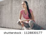 confident slender girl resting... | Shutterstock . vector #1128830177