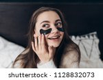 beautiful long haired girl woke ... | Shutterstock . vector #1128832073