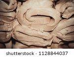 wet white clay closeup.... | Shutterstock . vector #1128844037