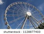 big ferris wheel in an... | Shutterstock . vector #1128877403