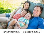 caucasian father and chinese...   Shutterstock . vector #1128955217