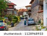 city landscape   elderly ladies ... | Shutterstock . vector #1128968933