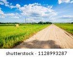 a view of a dirt road through... | Shutterstock . vector #1128993287