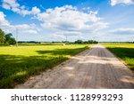 a view of a dirt road through... | Shutterstock . vector #1128993293
