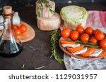 italian bruschetta with chopped ... | Shutterstock . vector #1129031957
