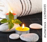 Wellness and spa concept with candles,close up - stock photo