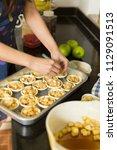 hands prepare apple crumble for ... | Shutterstock . vector #1129091513