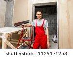 construction worker wearing... | Shutterstock . vector #1129171253