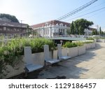 Small photo of JAKARTA, INDONESIA - July 7, 2018: Pedestrian walkway beside Krukut River on Kali Besar, Kota Tua.