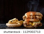 close up of home made burgers | Shutterstock . vector #1129302713
