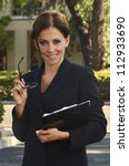 Beautiful hispanic woman in business attire/Hispanic Woman/Woman working - stock photo
