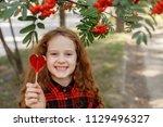 sweet little girl with a...   Shutterstock . vector #1129496327