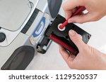 female hand rewinding cassette... | Shutterstock . vector #1129520537