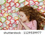 sweet little girl is sleeping.   Shutterstock . vector #1129539977