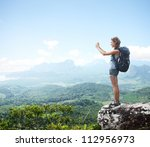 young woman with backpack... | Shutterstock . vector #112956973
