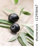 olives on wood background | Shutterstock . vector #112958467