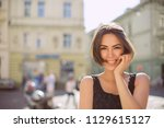 positive brunette woman with... | Shutterstock . vector #1129615127