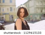 merry brunette woman with... | Shutterstock . vector #1129615133