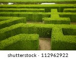 geometric pattern of green hedge flowerbed - stock photo