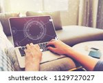 virtual icons with person using ... | Shutterstock . vector #1129727027