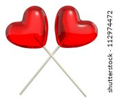 Two crossed heart shaped lollipops, isolated on white background - stock photo