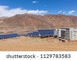 a solar power station under... | Shutterstock . vector #1129783583