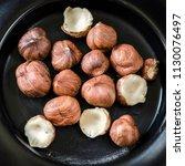 hazelnuts nuts in bowl. food... | Shutterstock . vector #1130076497