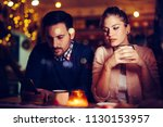 sad couple having conflict and... | Shutterstock . vector #1130153957