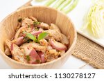 Small photo of Hot and Spicy Grilled Pork Salad on a white background, Nam Tok Moo