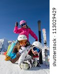 Winter, snow, sun and fun - family enjoying winter vacations ( space for text) - stock photo