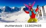 Winter, snow, sun and fun - family enjoying winter vacations - stock photo