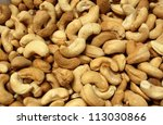 Freshly roasted cashew nuts with salt added - stock photo