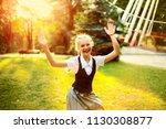 schoolgirl in uniform with... | Shutterstock . vector #1130308877