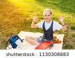 happy schoolgirl in uniform... | Shutterstock . vector #1130308883