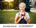 happy schoolgirl with pigtails... | Shutterstock . vector #1130308907
