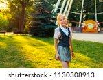 portrait of happy schoolgirl in ... | Shutterstock . vector #1130308913