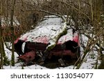 Abandoned Car In The Snow In A...