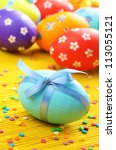 Easter decorations - eggs with painted flowers on the tabletop - stock photo