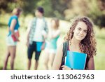 young female student at park... | Shutterstock . vector #113062963