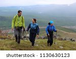 group of tourists guy and two... | Shutterstock . vector #1130630123
