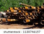 oil drill pipe. rusty drill... | Shutterstock . vector #1130746157