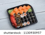 salmon and caviar rolls served... | Shutterstock . vector #1130930957